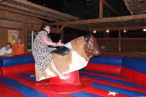 Guests having fun riding the bull at Longshadow Winery in Temecula, CA